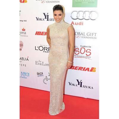 Eva Longoria sexy in Gold