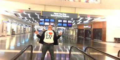 Mann dreht Musikvideo auf Flughafen