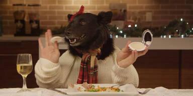 Tiere mit Menschen-Händen beim Essen