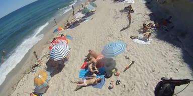 Paragleiter landet auf Sonnenbader