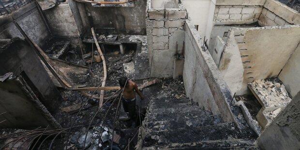 Neun Tote bei Brand in Wohnsiedlung