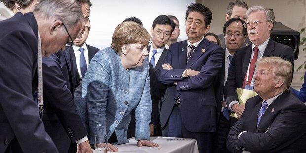 Merkel sorgt mit Trump-Bild für Lacher