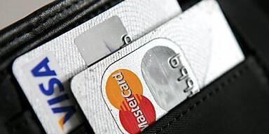 Die Kreditkartenkonzerne profitieren vom Anziehen der Kauflaune.