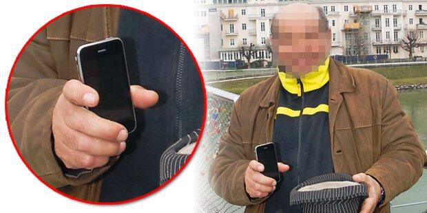 Bettler protzt mit seinem neuen iPhone