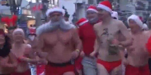 Weihnachtsmänner halbnackt in Budapest