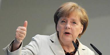 Angela Merkel *thumbs up*