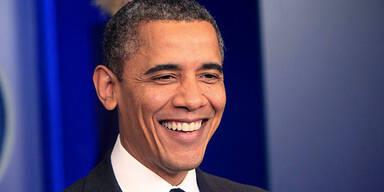 Barack OBAMA / lachend / grinsend / fröhlich
