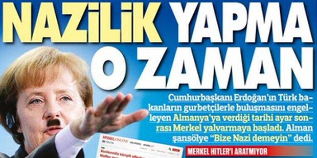 Zeitung zeigt Merkel mit Hitler-Bart