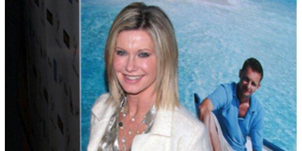 Olivia Newton-Johns totgeglauber Ex am Leben?