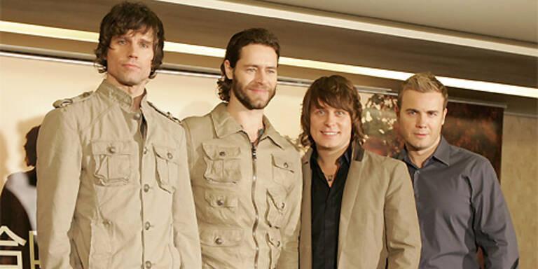 Die angeblich sexiest Männer der Welt: die Jungs von Take That - Jason Orange, Howard Donald, Mark Owen und Gary Barlow (v.l.). (c) Reuters