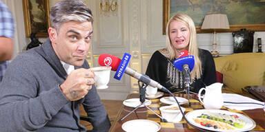 Robbie Williams und Claudia Stöckl