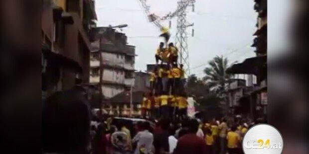 Autsch: Akrobaten-Pyramide stürzt ein