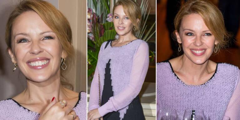 Liebes-Aus hin oder her, ihre Arbeit will Kylie Minogue nach der Trennung von Model Andres Velencoso nicht schleifen lassen. Bei einer Benefizauktion zugunsten der Krebsforschung schluckte die Sängerin ihren Kummer hinunter und lächelte tapfer. Wie traurig sie in ihrem tiefsten Inneren sein muss, ließ sie sich nicht anmerken.