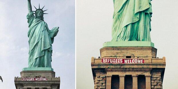 """Refugees Welcome""-Banner an der Freiheitsstatue gehisst"