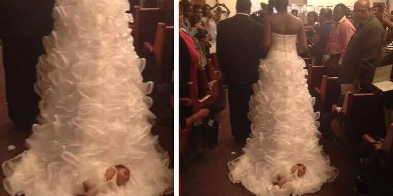 Braut zerrt Baby auf Hochzeitskleid zum Altar