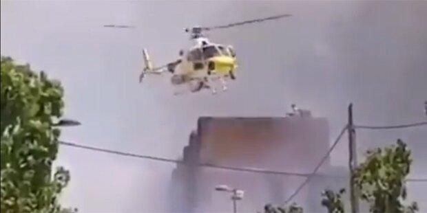 Heli rettet Menschen aus Flammen-Inferno
