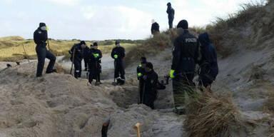 Flüchtling getötet und im Sand vergraben