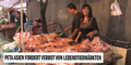 Fleischändlerin auf asiatischem Lebensmittelmarkt.