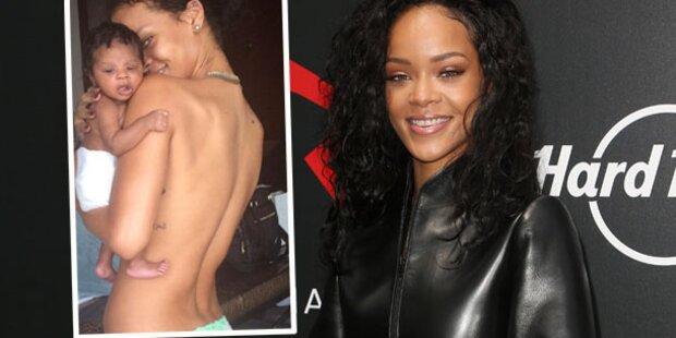 Rihanna kuschelt oben ohne mit Babynichte