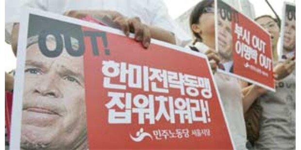 Bush mit scharfem Protest in Seoul empfangen