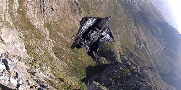 Base-Jumper kracht in Felsen und stürzt ab