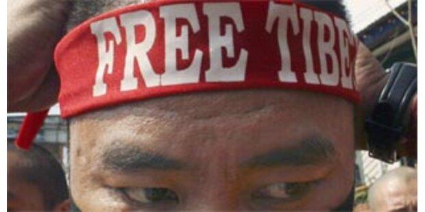 Tibetaktivisten störten olympischen Fackellauf