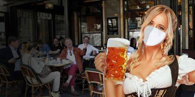 Kellnerin mit Maß Bier und Maske