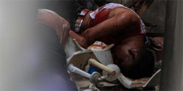 18 Tote bei Massaker in Schuhfabrik