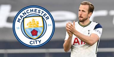 Tottenham-Star Harry Kane applaudiert - Wappen von Manchester City