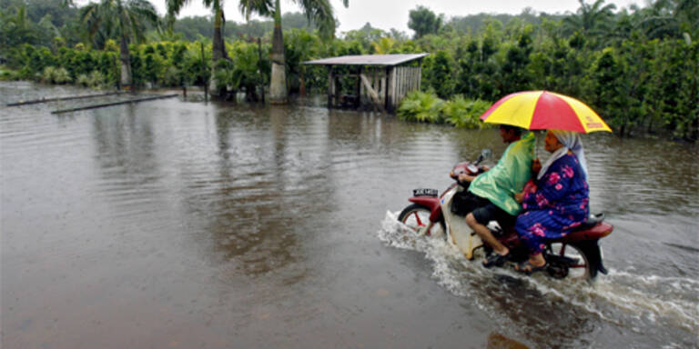 (c) AFP/ Tengku Bahar