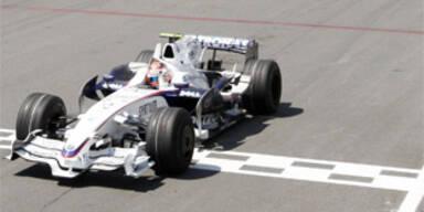 Zieleinfahrt des Polen Robert Kubicas, die seinen ersten GP-Erfolg brachte