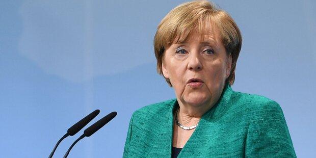 Merkel: Opfer der Krawalle werden entschädigt