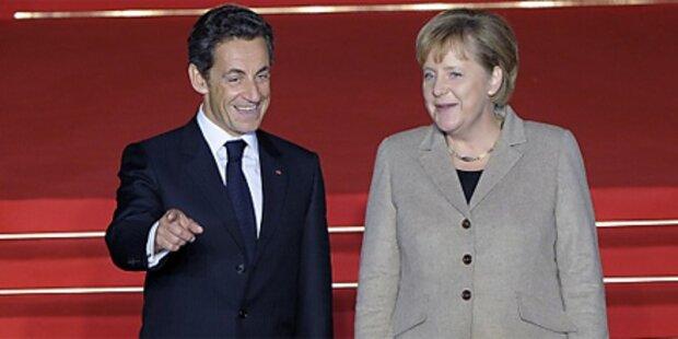 Merkel & Sarkozy einig über Defzitstrafe