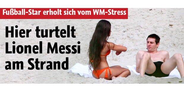 Hier turtelt Lionel Messi am Strand