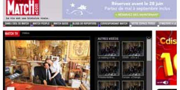 Kuscheln am Schreibtisch von Sarkozy