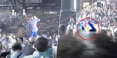 Robbie Williams bricht Fan den Arm