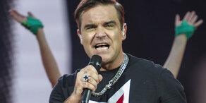 Robbie Williams singt mit seinen Kids