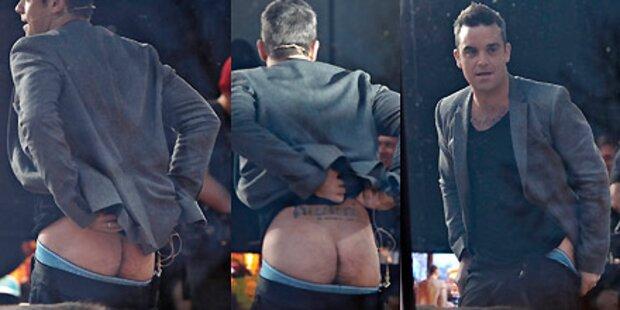 Robbie Williams zeigt seinen blanken Po!