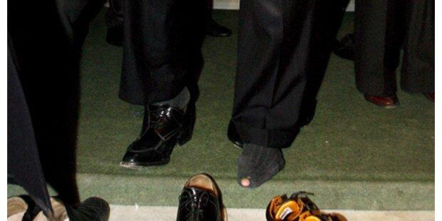 Unternehmer schenken Wolfowitz 12 Paar Socken