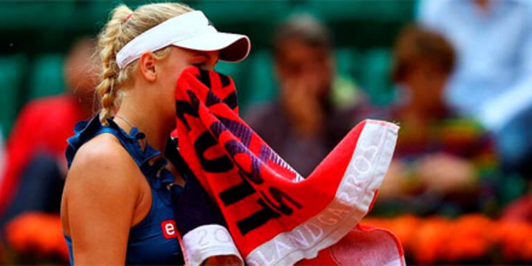 Federer locker weiter, Wozniacki out
